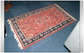 Indo Persian Small Size Rug with a rust coloured ground with a floral decoration. 60x36''