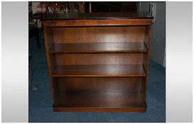 An Oak Open Shelf Standing Bookcase with 2 adjustable shelves. With a tooth edge molding to the top.
