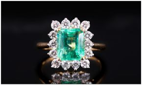 Ladies 18ct Gold Set Emerald & Diamond Cluster Ring, The Central Faceted Natural Emerald Of