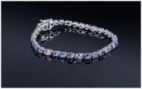 Tanzanite and White Topaz Tennis Bracelet, oval cut tanzanites,