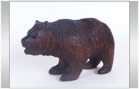 A Carved Black Forest Bear. 6.5 Inches In Length, With Bead Eyes.