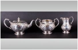 A Very Fine Mid Victorian Silver Plated 3 Piece Tea Service with Embossed Floral Decoration.