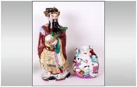 Two Chinese Famile Rose FIgures one of a standing wise man holding a Ruya, 15'' in height, The other