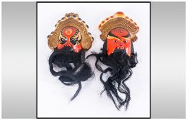 Pair Of Pottery Decorated Chinese Mask Figures With Beards incised Character marks to the verso,