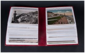 A Small Album of Mixed Blackpool Postcards approximately 56 including Blackpool Illuminations etc