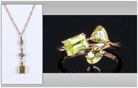 A 9ct Gold Peridot Set Pendant Drop Fitted To a 9ct Gold Chain. Marked 9.375.