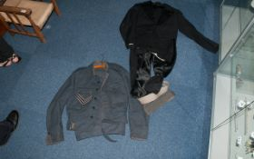 An RAF WW2 Standard Uniform with hat with RAF badge and belt. Numbered 1086899 BROWN.