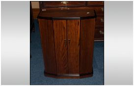 An Oak Doulbe Door CD Cabinet with fitted interior.