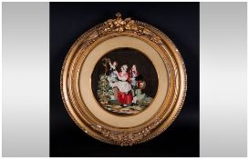 An Early 19th Century Tapestry Embroidery of rural folk depicting children in an ornate gilt frame.