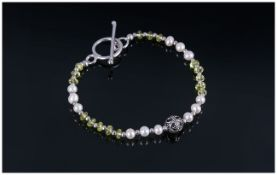 Peridot and Fresh Water Pearl Bracelet, faceted rondelles of peridot interspaced with small silver