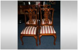 A Set of Four Beech Walunt Stained Chippendale Style Chairs.