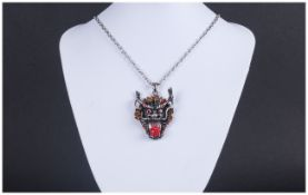 Oriental Dragon Head Pendant, the blackened face framed with golden orange crystal 'dragon's