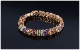 Multi Gemstone Three Row Bracelet, comprising oval cuts of amethyst, red garnet, peridot,
