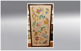 A 1930's Framed Floral Needlework Picture in Vivid Colours. Framed and Glazed. 14 by 40 inches.