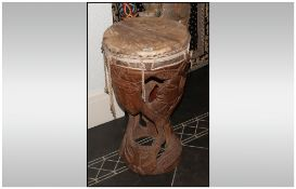 A Carved Wood Ethnic Drum probably from Africa. With a camel skin top.