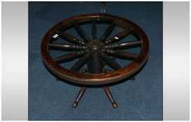 A Capstan Wheel Topped and Glazed Oak Coffee Table.