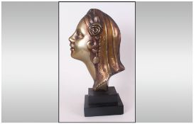 Art Deco 1930's Bronze Bust Of A Young Woman Wearing A Rose And Head Dress raised on black marble