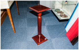 A Small Mahogany Plant Pot Pedestal in the Regency Style.