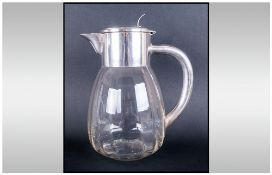 A German Early 20th Century Silver Plated And Glass Lidded Ice Jugs Of Bulbous Form in the style of