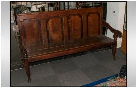 A Lancashire Oak Hall Bench with a four panelled Chamfered shaped back. On O G shaped arms.