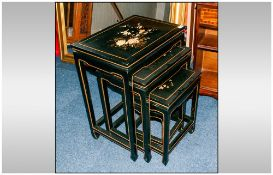 A Nest Of Four Black Lacquered & Decorated Chinese Tables.