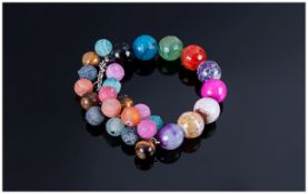 Multicolour Agate and Tiger Eye Bracelet, a row of polished, faceted, multicoloured agates,