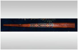 An Australian Traditional Didgeridoo. With Aboriginal dot painted Salamander decoration.