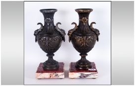Pair of French Stylised Metal Patinated Urns with Dolphin Handles,