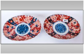 Pair Of Fluted Oval Imari Dishes with typical imari palette. 8x5''. Late Meiji Period.