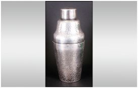 Art Deco Silvered Metal Cocktail Shaker with a planished beaten body, impressed mark to base. NR.
