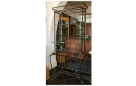 Wrought Iron Contemporary Display Stand with three exposed glass shelves support with wrought iron