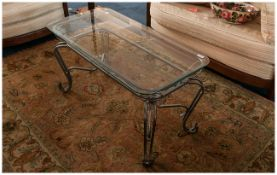 Continental Wrought Iron Coffee Table In The French Style with shaped legs & glass top. 20x40'' 20''