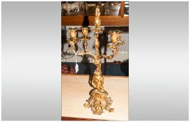 Antique French Ormolu Candelabrum In The Rococo Style, With a Central figure of a young girl holding