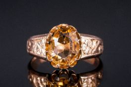 Ladies Antique 9ct Gold Set Topaz Single Stone Ring with engraved floral shoulders. Marked 9ct. 3.