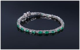 Emerald and White Topaz Tennis Bracelet, oval cut emeralds of good colour, interspaced with square