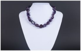 Amethyst Smooth Tumbled Bead Necklace, rich purple baroque amethysts, hand knotted onto purple silk,