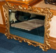 Composition Rococo Shaped Gilded Wall Mirror, With Bevelled Mirror. 40 x 30 Inches.