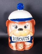 A Japanese Novelty Earthenware Lidded Biscuit Jar, Complete with box. 12'' in height.