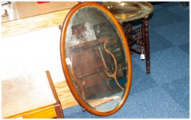Oval Inlaid Mahogany Framed Edwardian Mirror with bevelled edge.