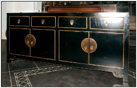 Chinese Black Lacquered Credenza Cabinet of two cupboard configuration below four drawers. With