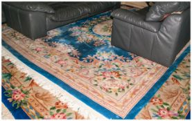 Large Pale Blue Ground Chinese Embossed Carpet with the central medallion picked out in Ivory with