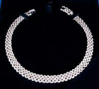 Swarovski necklace Boxed, 14'' in Diameter. Excellent Condition.