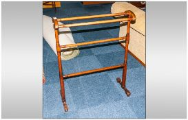 An Antique Turned Wood Towel Rail Stand, With Shaped Top Supports on Turned Feet.
