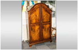 A Burr Walnut Queen Anne Style Double Door Panel Door Front Wardrobe, with a Shaped Canopy Top and