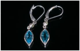 Swiss Blue Topaz Drop Earrings with peridot accents, the blue topaz of 2.6cts, in marquise cuts,