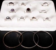 A Collection of Stone Set Silver Dress Rings ( 10 ) In Total + 3 Silver Bangles. All Fully Marked