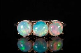 Opal Three Stone Ring, three round cut cabochon opals, with an excellent display of colours, each of