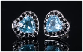 Sky Blue Topaz and Black Spinel Heart Shaped Earrings, each stud earring comprising a heart cut