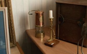 Copper & Brass Miners Lamp, Serial Number 16742. with a brass anchor candlestick.