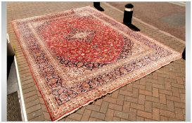 A Large Persian Carpet In The Meshad Style, with a central floral motif with corresponding blue